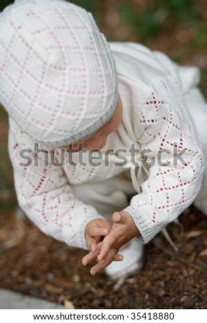Small child in the park. - stock photo