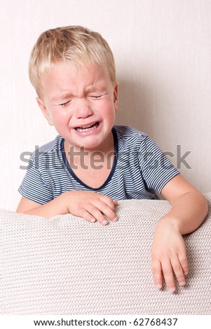 Small child is cry, indoor. - stock photo