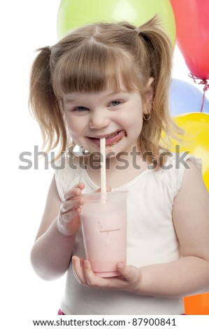 small child is drinking her strawberry milk shake