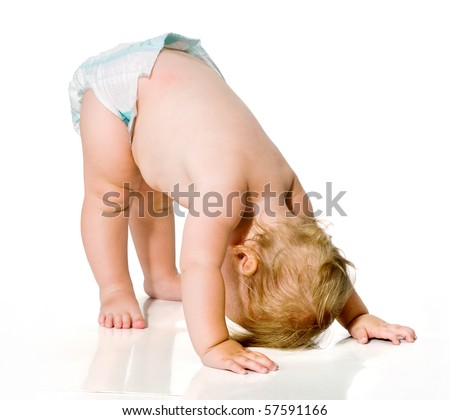 small child learning to walk.first steps.image on white background. toddler. - stock photo