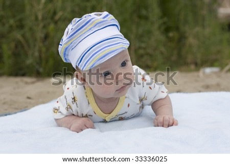 Small child lies on a stomach - stock photo