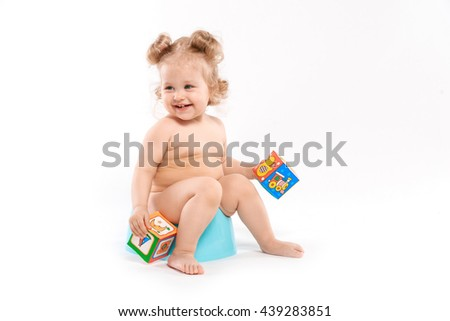 small child on the pot on a white background - stock photo