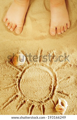 Small Child's Feet in the Sand. - stock photo