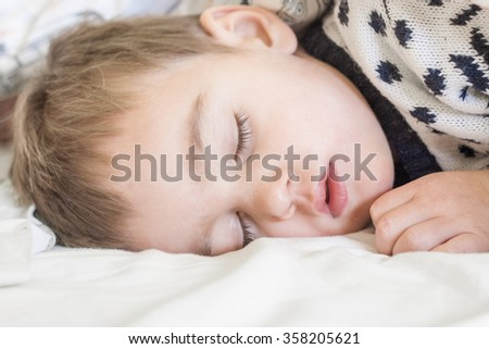 Small child sleeping - stock photo
