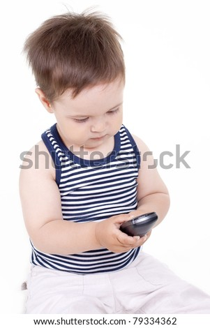 small child with a phone on a white background