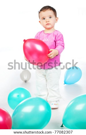 small child with colorful balloons in the studio - stock photo