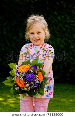 Small child with flowers. Gift for Mother