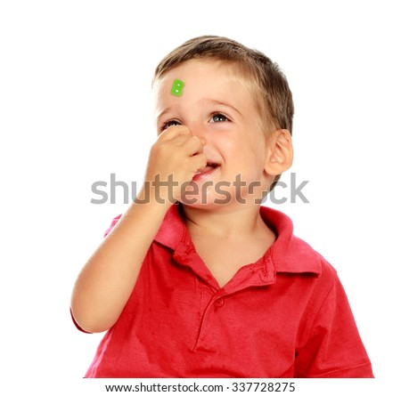 Small child with stickers of letters on the face