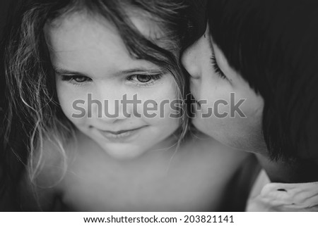 small children brother and sister, black and white portrait - stock photo