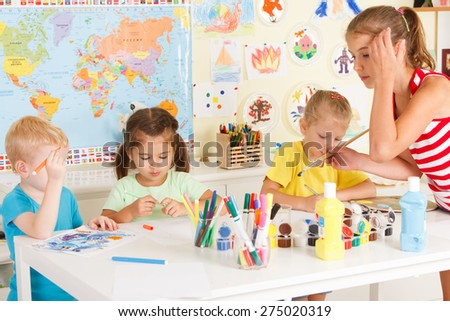 small children draw in the classroom - stock photo