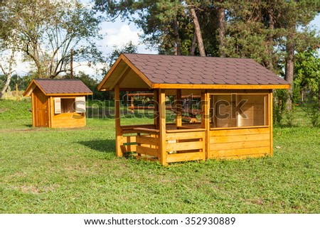 Small children houses made of wood in an Italian park - stock photo