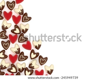 small chocolate and pink valentine velvet hearts on white background