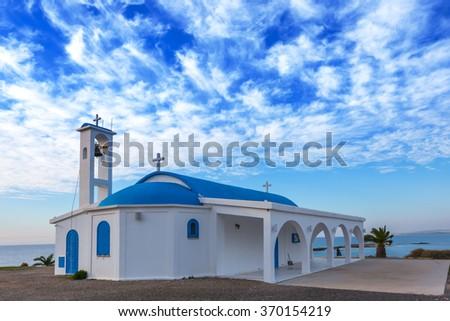 small christian church on a blue sky background - stock photo