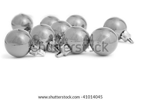 Small Christmas baubles in high key mono with a white background - stock photo