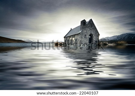 Small church in New Zealand engulfed in a flooded lake - stock photo