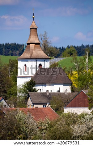 Small church in village in Czech republic Priseka. Beautiful view to spring vysocina countryside. Rural scene - stock photo