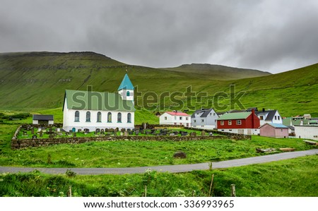 Small church with cemetery in the village of Gjogv located on the northeast tip of the island of Eysturoy, Faroe Islands, Denmark - stock photo