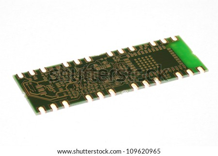 small circuit board with many components in the electrical engineering on white background - stock photo