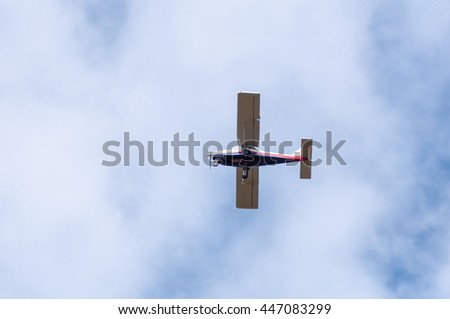 small civil ultralight cessna airplane and blue sky - stock photo