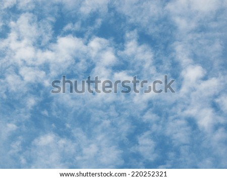 small clouds in the sky - stock photo