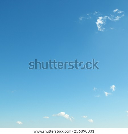 small clouds on blue sky - stock photo
