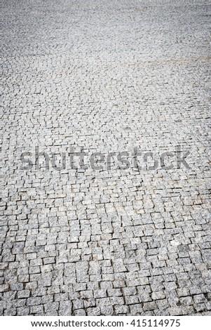 Small cobblestone sidewalk made of cubic stones - stock photo