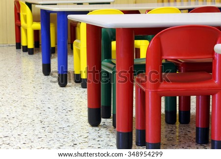 small colored tables and chairs in the refectory of the kindergarten - stock photo