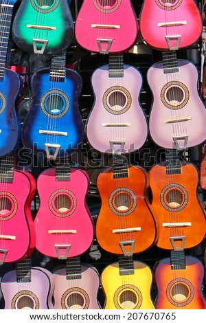 Small colorful guitars