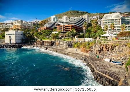 small concrete beach near bath complex Lido in Funchal, Madeira island, Portugal - stock photo