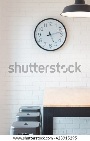 small conference table and metal stools in white room. - stock photo