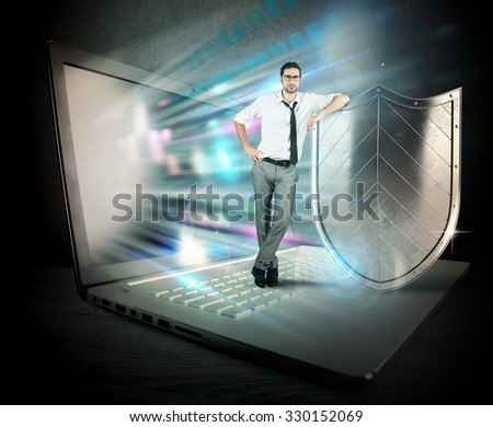 Small confident businessman with computer and shield - stock photo
