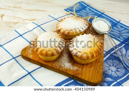 Small confiture pies and baking sieve. Jam pie. Small pie. Pie. Sweet pastry. Sweet dessert  - stock photo