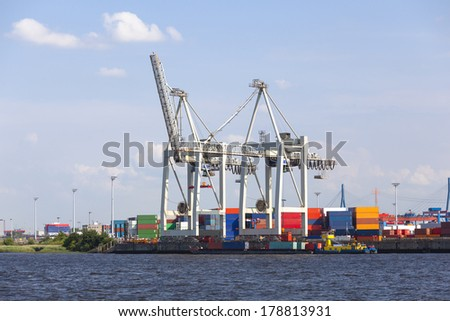 Small container harbor with tall cranes in Hamburg Harbor, Germany - stock photo