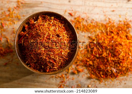 Small copper pot containing a precious spice: saffron, made from a type of crocus flower. - stock photo