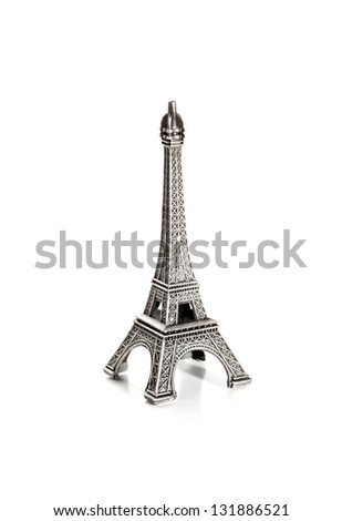 Small copy of eiffel tower on white background - stock photo