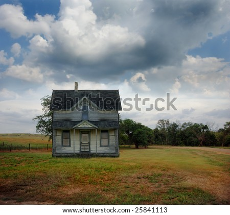 Small country farmhouse out on the prairie in South Dakota. - stock photo