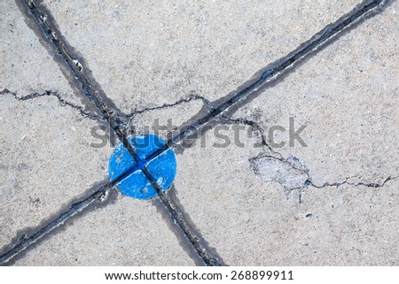 Small cracks on concrete sidewalk - stock photo