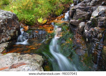 Small creek cascade in the Lewis and Clark National Forest of Montana - stock photo