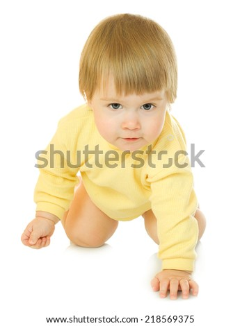 Small creeping baby in yellow isolated - stock photo