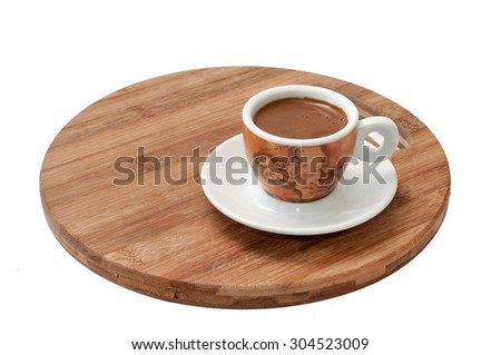 Small cup of coffee served on wooden board. - stock photo