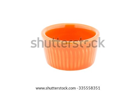 Small cup orange color isolated on white - stock photo