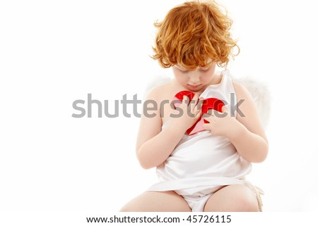 Small cupid presses to a breast the heart, isolated