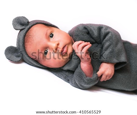 Small cute baby girl in toddler and mouse hat isolated - stock photo