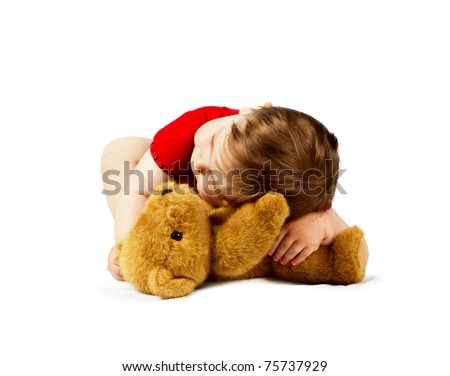 Small cute boy with teddy bear toy isolated on white - stock photo
