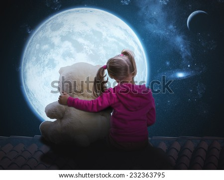 Small cute girl sitting with toy bear - stock photo