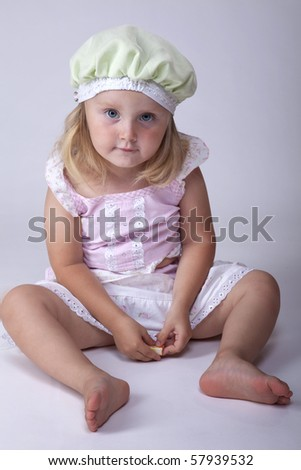 Small cute little girl sitting on the floor