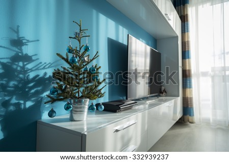 Small decorated christmas tree bucket on stock photo edit now