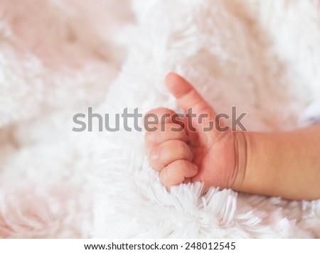 Small delicate little hand of newborn - close portrait - stock photo