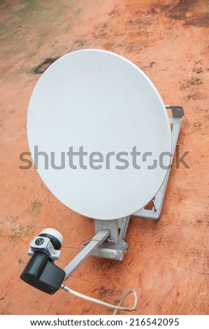 Small digital satellite reciever on roof - stock photo