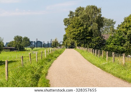 Small dike road along the Vecht  in Overijssel Holland - stock photo
